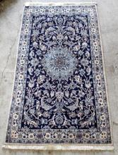 A Persian Nain Wool Pile Rug with Floral Design and Central Medallion
