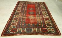 A Persian Carpet in Red and Blue tones