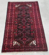 A Persian Rug in Burgundy and Red tones