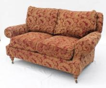 A Rolled Arm Two Seater Sofa