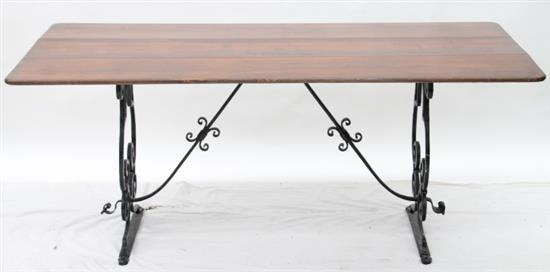 A Timber Dining Table with Wrought Iron Base : H3561 L103296950 from www.invaluable.co.uk size 550 x 272 jpeg 13kB