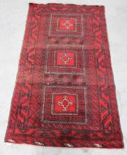 A Persian Rug featuring Geometric Motifs in Red and Black