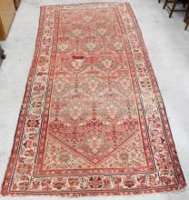 A Persian Rug in Red and Black Tones, with a Floral Motif.