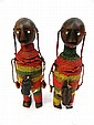 Pair of Ashanti fertily dolls. Carved wood profusely decorated with coloured beads and leather magic pouches 19cm