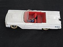 A French Dinky Toy Ford Thunderbird No 555 in white and red