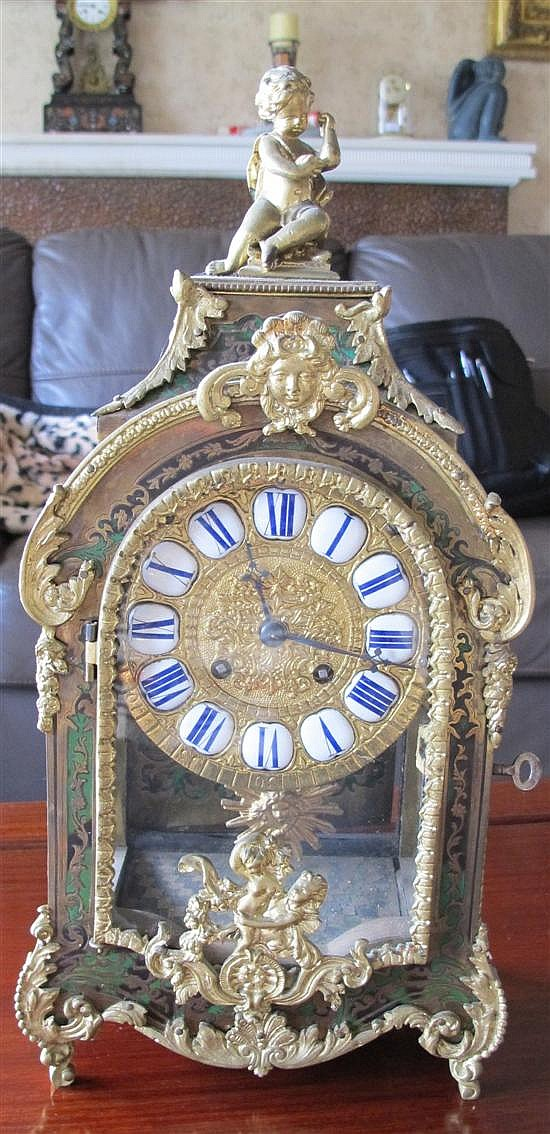 A 19th Century French Boulle mantel clock,