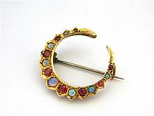 An Australian 9ct Yellow Gold Opal and Garnet Crescent Brooch