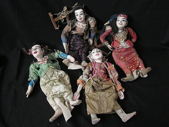 A group of four puppets