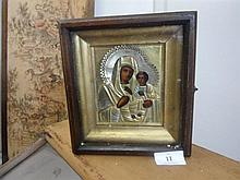 A Russian framed  Icon in wood and glass box