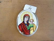An Icon in metal frame, enamelled