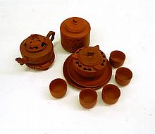 A Chinese Yixing Pottery Tea Set