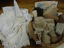 Two baskets with various lace items, edgings, table cloths etc