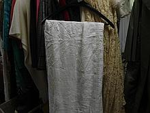 A large linen embroidered table cloth