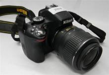 A Nikon D5100 digital camera, charger & remote AF