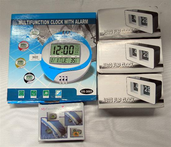 A collection of five assorted clocks incl. auto flip clocks & vibrating pillow alarm clock