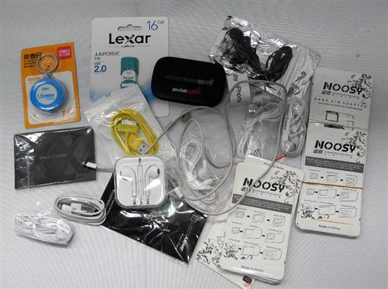 An assortment of ear buds, flash drives etc.