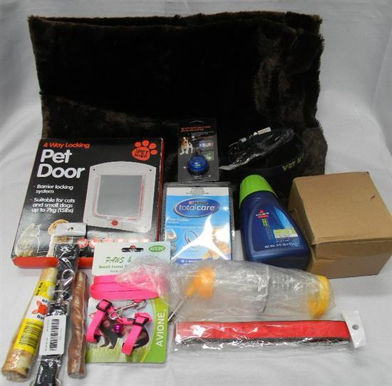 A quantity of pet products incl. pet door, mat, collars etc.
