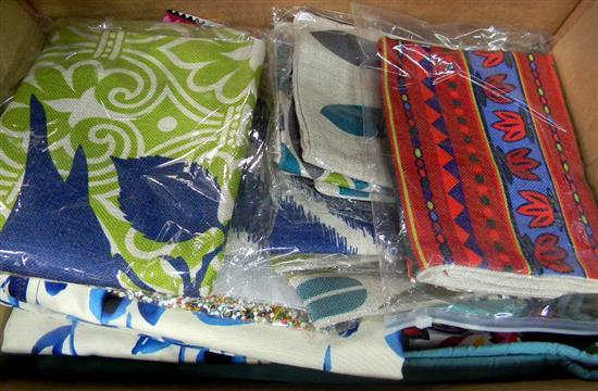 A box of assorted cushion covers