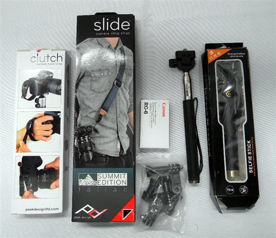 An assortment of camera accessories incl. straps, selfie-sticks etc.