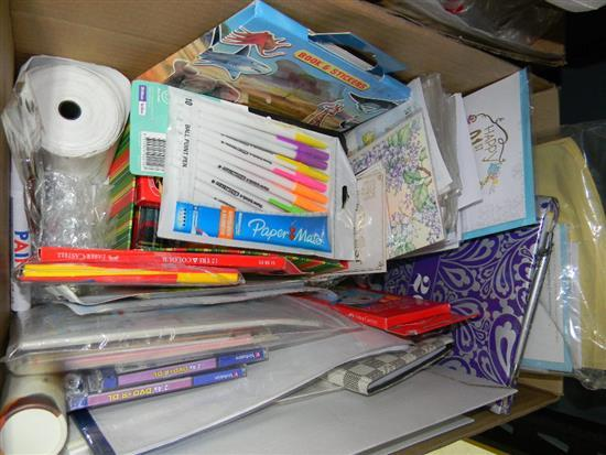 A box of assorted stationery items, pens cards etc.