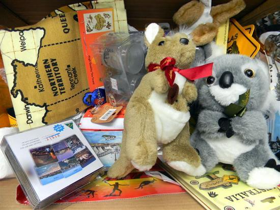 A box of assorted souvenir ware incl. coasters, plush toys etc.