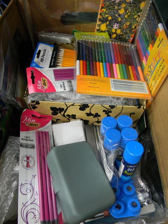 A box of assorted stationery items incl. pencils, glue sticks etc.