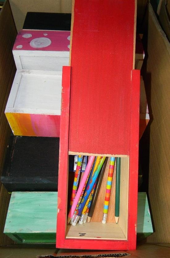A box of kid made pencil boxes & contents