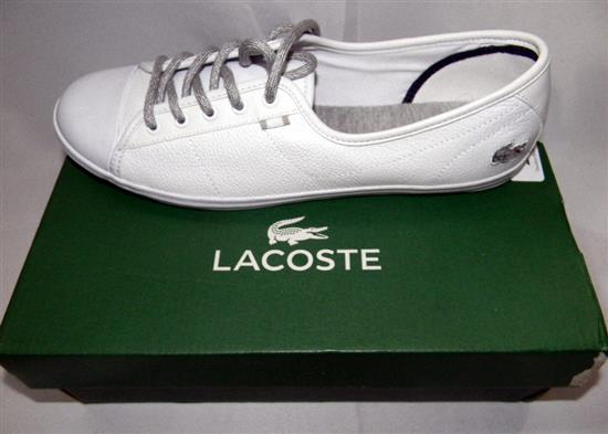 A pair of ladies white shoes marked Lacoste size 42