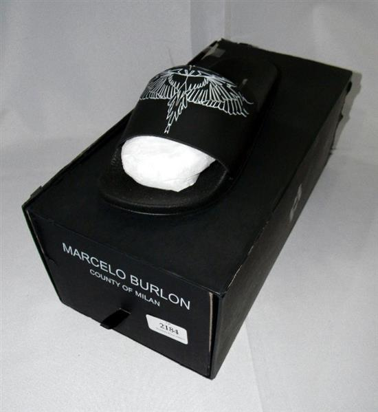 A pair of slip-on's marked Marcelo Burlon size 38