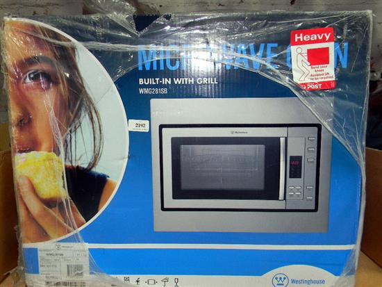 A Westinghouse WNG281SV microwave oven in sealed box