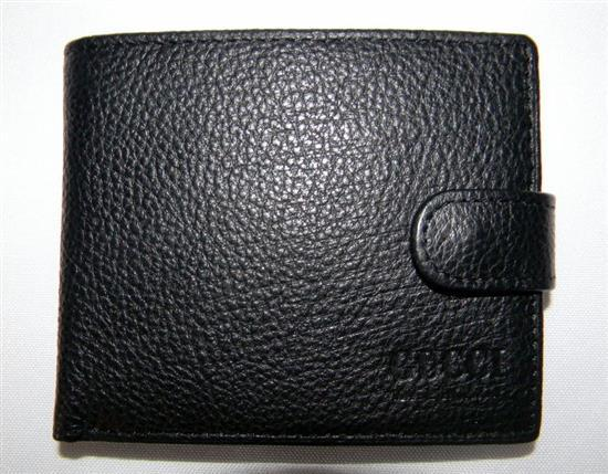 A black leather embossed mens wallet marked Gucci