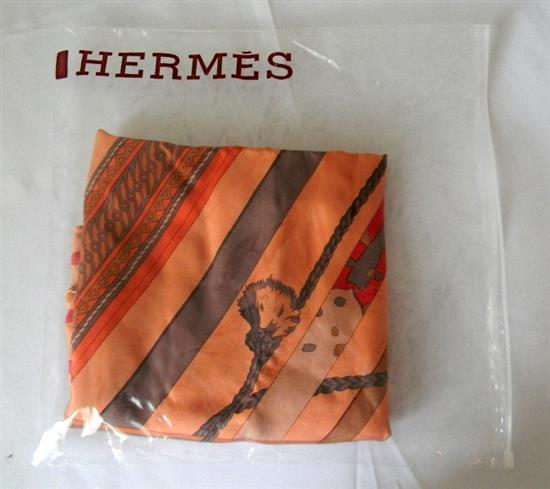 A ladies silk scarf marked Hermes