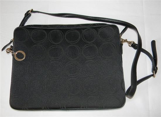 A black ladies fashion bag marked Oroton