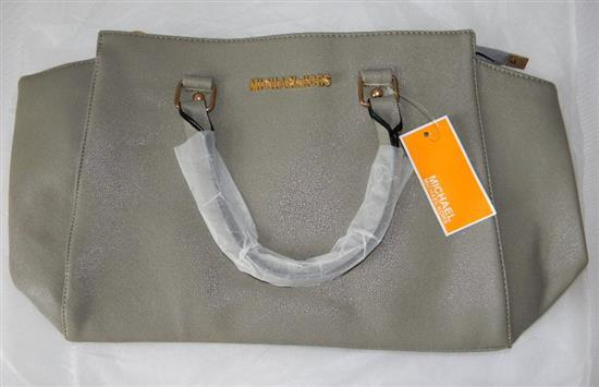 A ladies fashion hand bag marked Michael Kors in gunmetal
