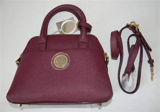 A Burgundy leather ladies fashion hand bag marked Oroton