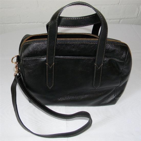 A black leather hand bag marked Fossil