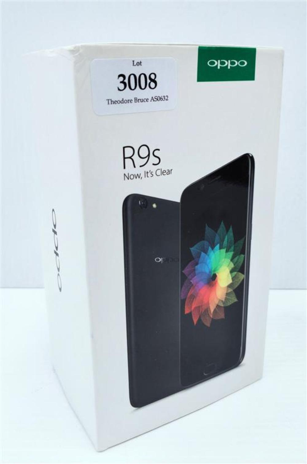 A smart phone marked Oppo R9S in open box, black, 4GB appears unused