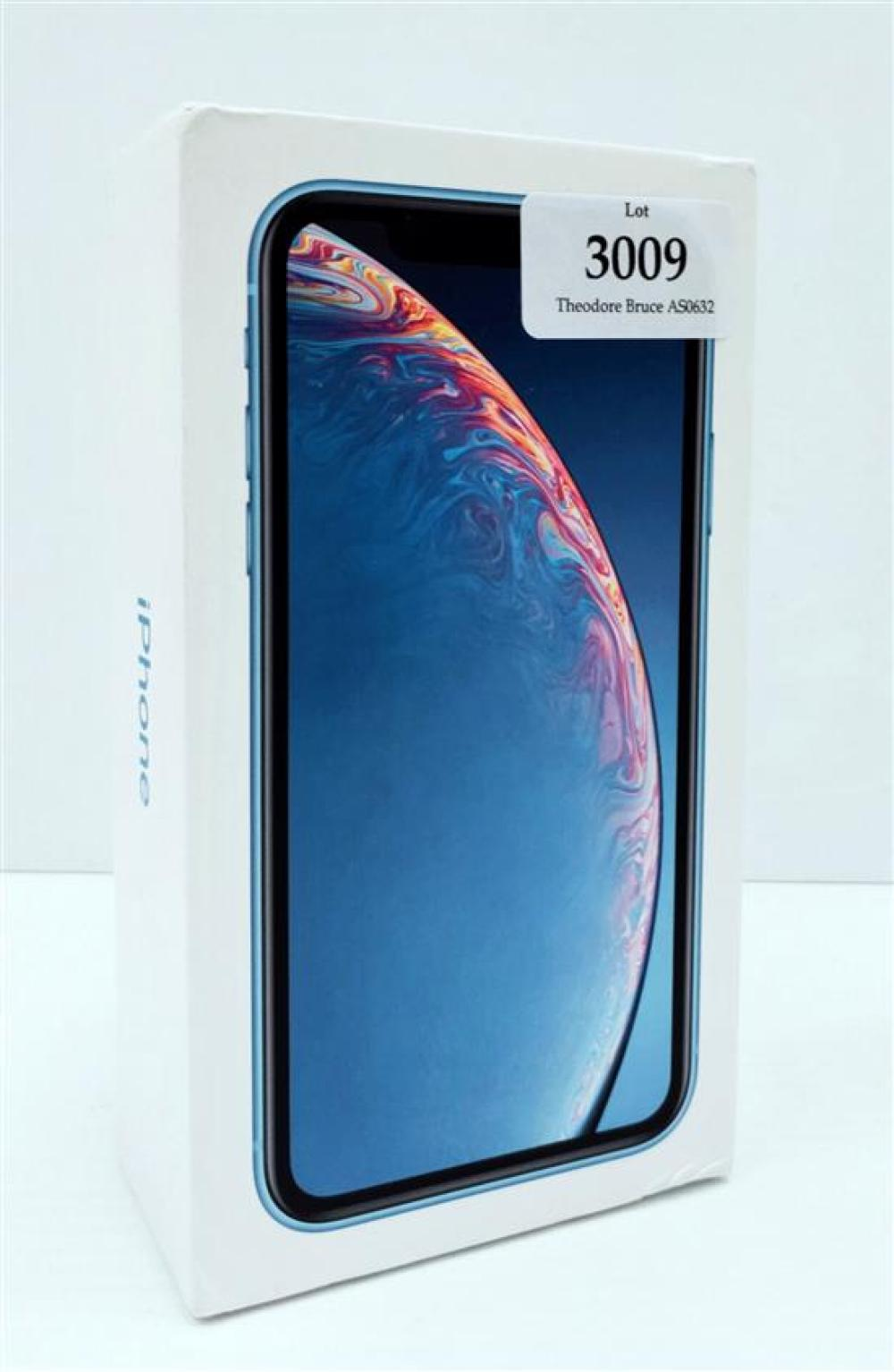 A smart phone marked Apple iPhone XR Blue 256 GB in open box, appears unused