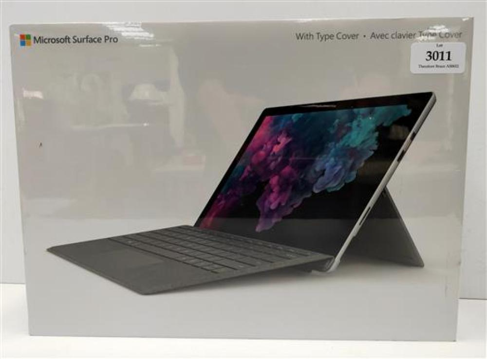 A tablet marked Microsoft Surface Pro 8th Generation Intel i5 processor, 128 GB in sealed box
