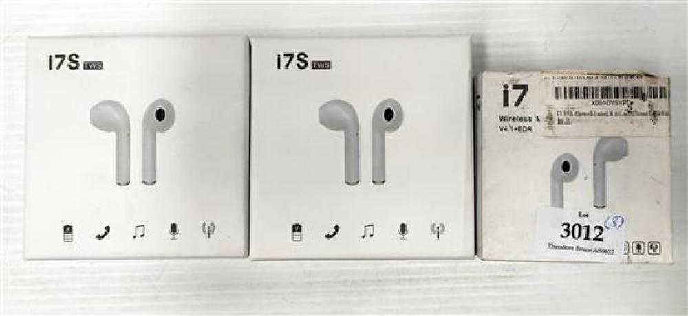 Two pairs of wireless headphones marked i7S & a single one marked  i7