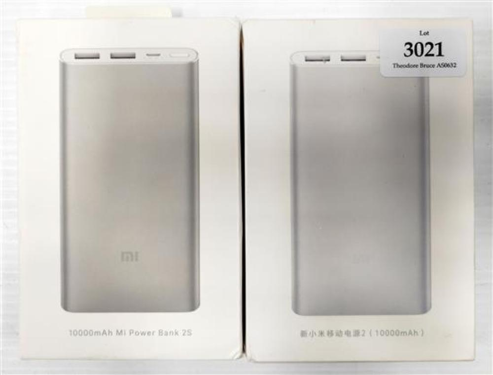 Two assorted power banks marked MI