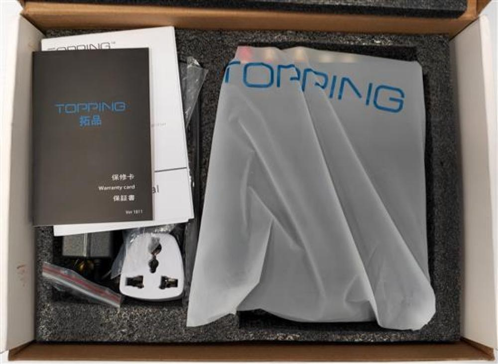 A multi function desk top digital amplifier marked Topping in open box
