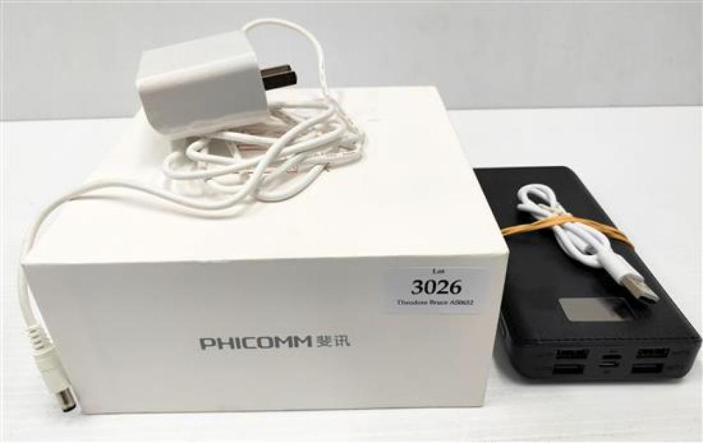 An android TV box marked Phicomm N1 plus phone charger