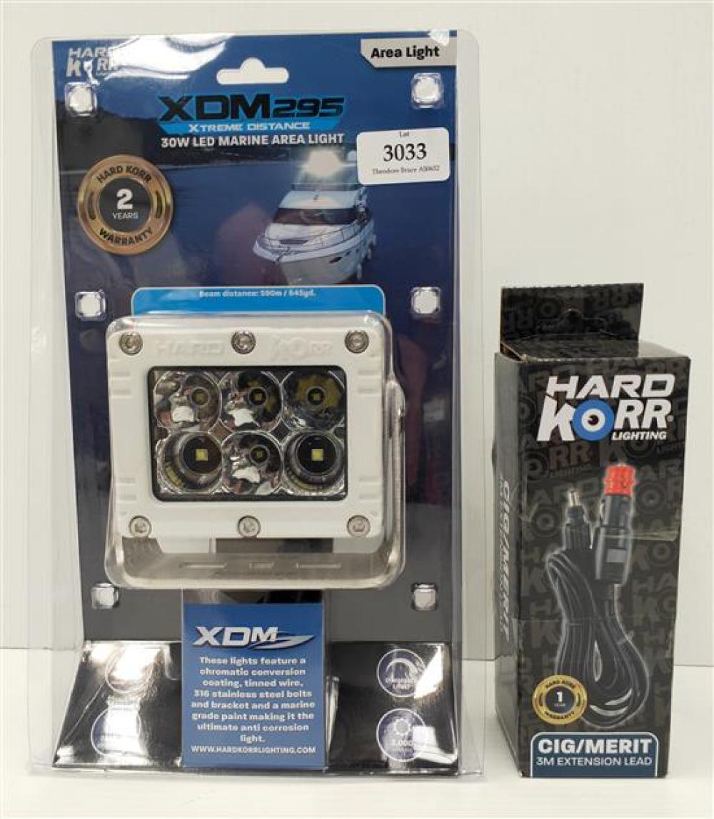 A marine light marked Hard Corr XDM295 with charger