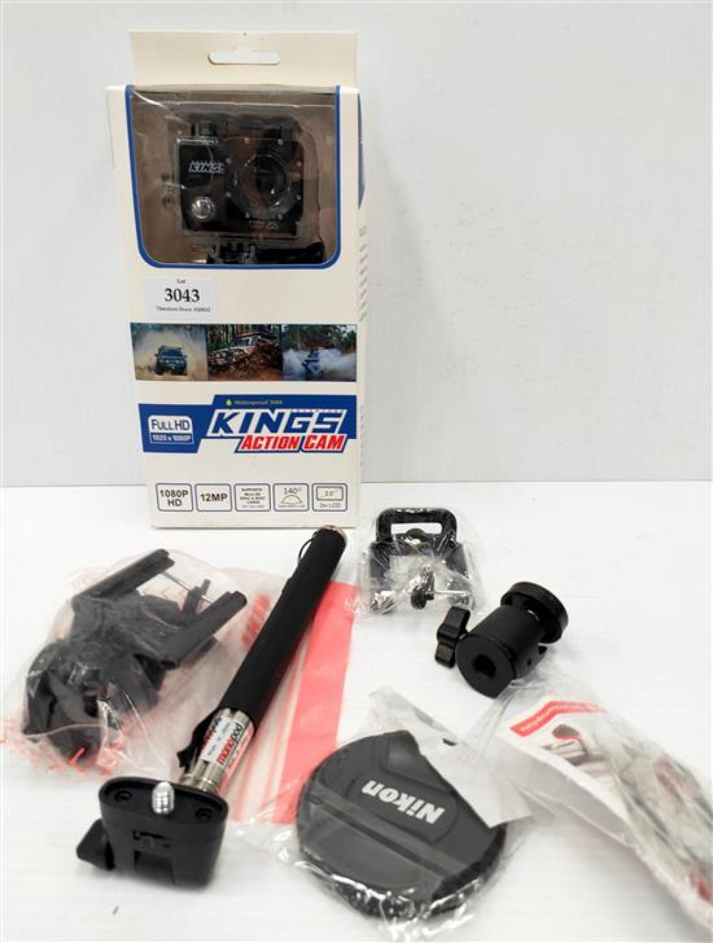 An action cam marked Kings plus assorted camera accessories