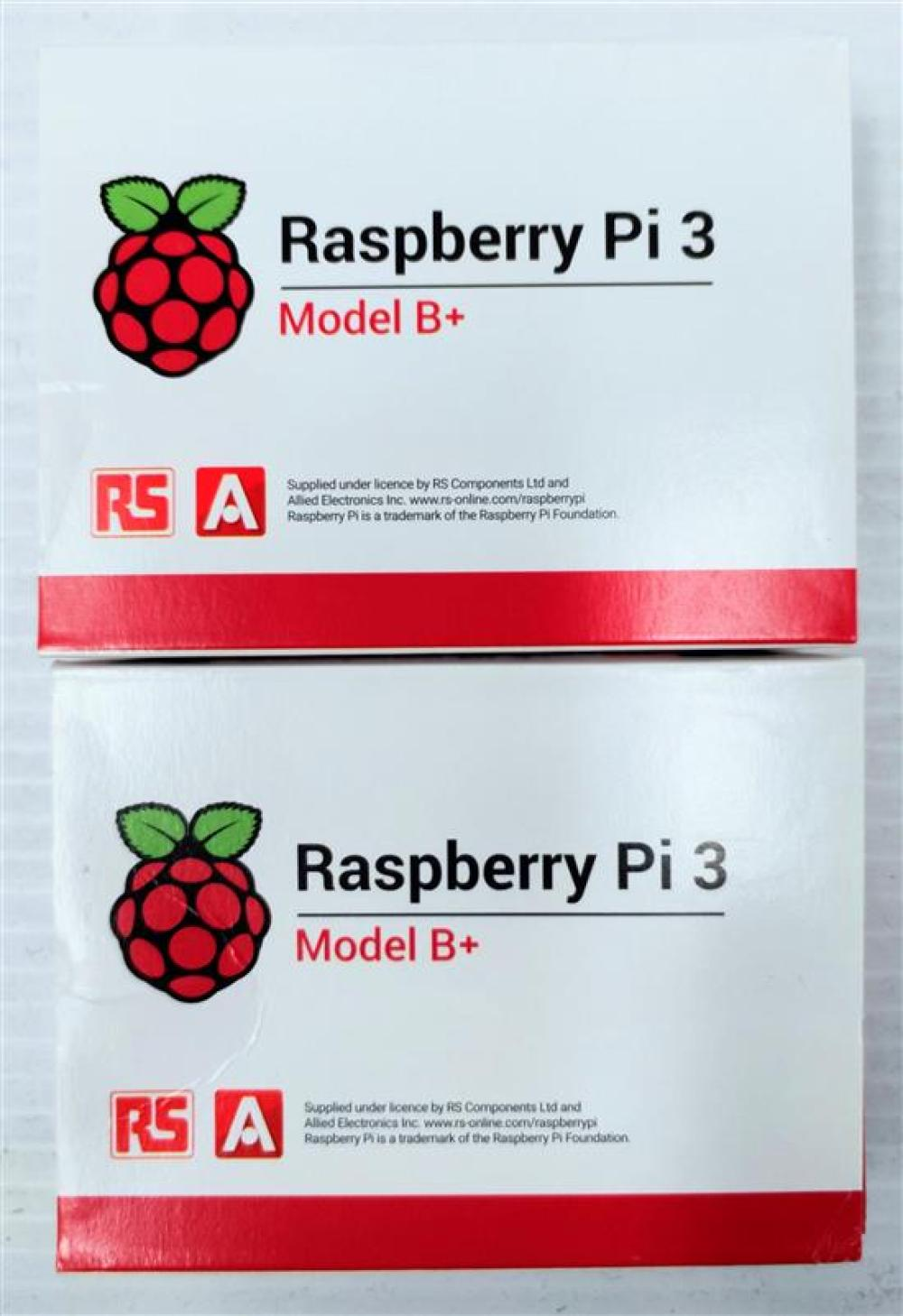 Two computers marked Raspberry Pi 3 model B+ in sealed box