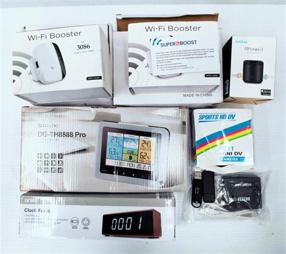 A selection of electrical items incl. wifi booster, mini action cam & baromoter