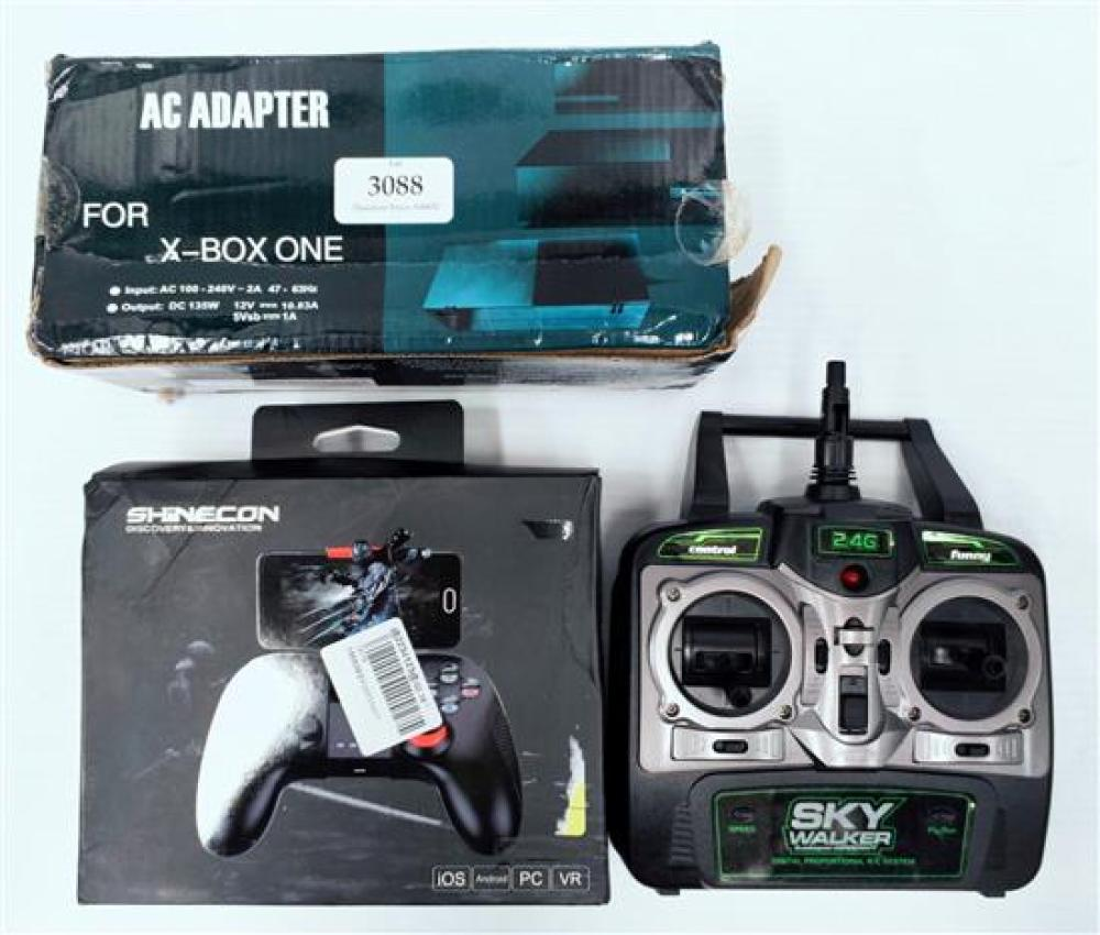 A remote control hand set & AC adaptor for Xbox 1 in open box