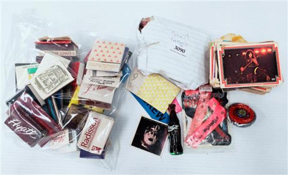 A collection of vintage Kiss collector cards, match boxes, Tazo etc.