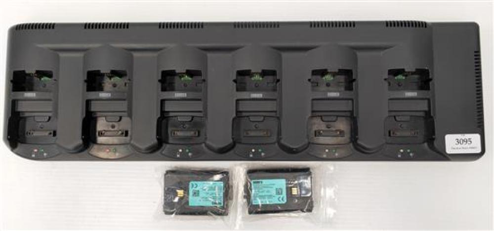 A battery charging unit marked Supura STP8000 plus two batteries